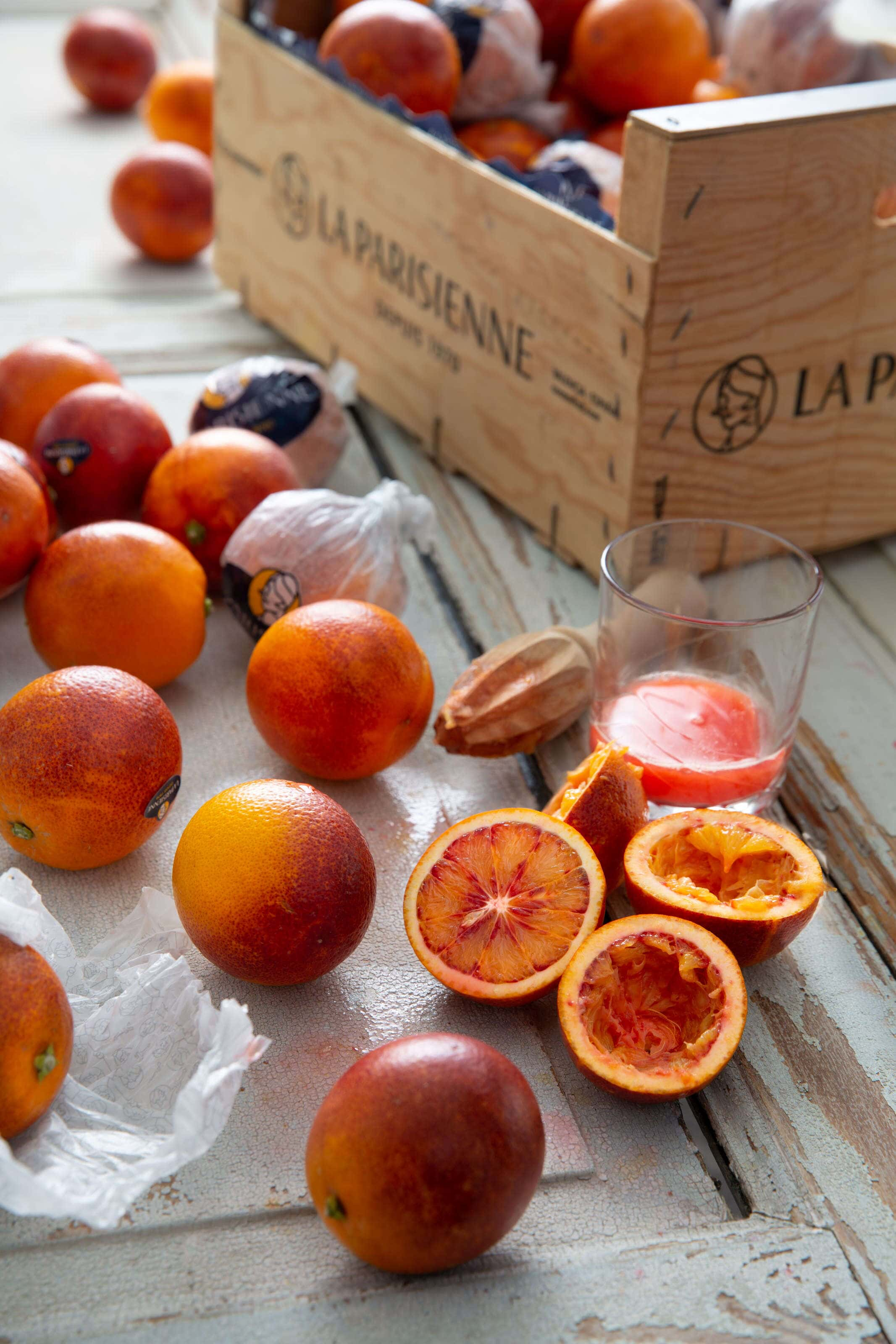 Blood oranges, whole, halved and juiced.
