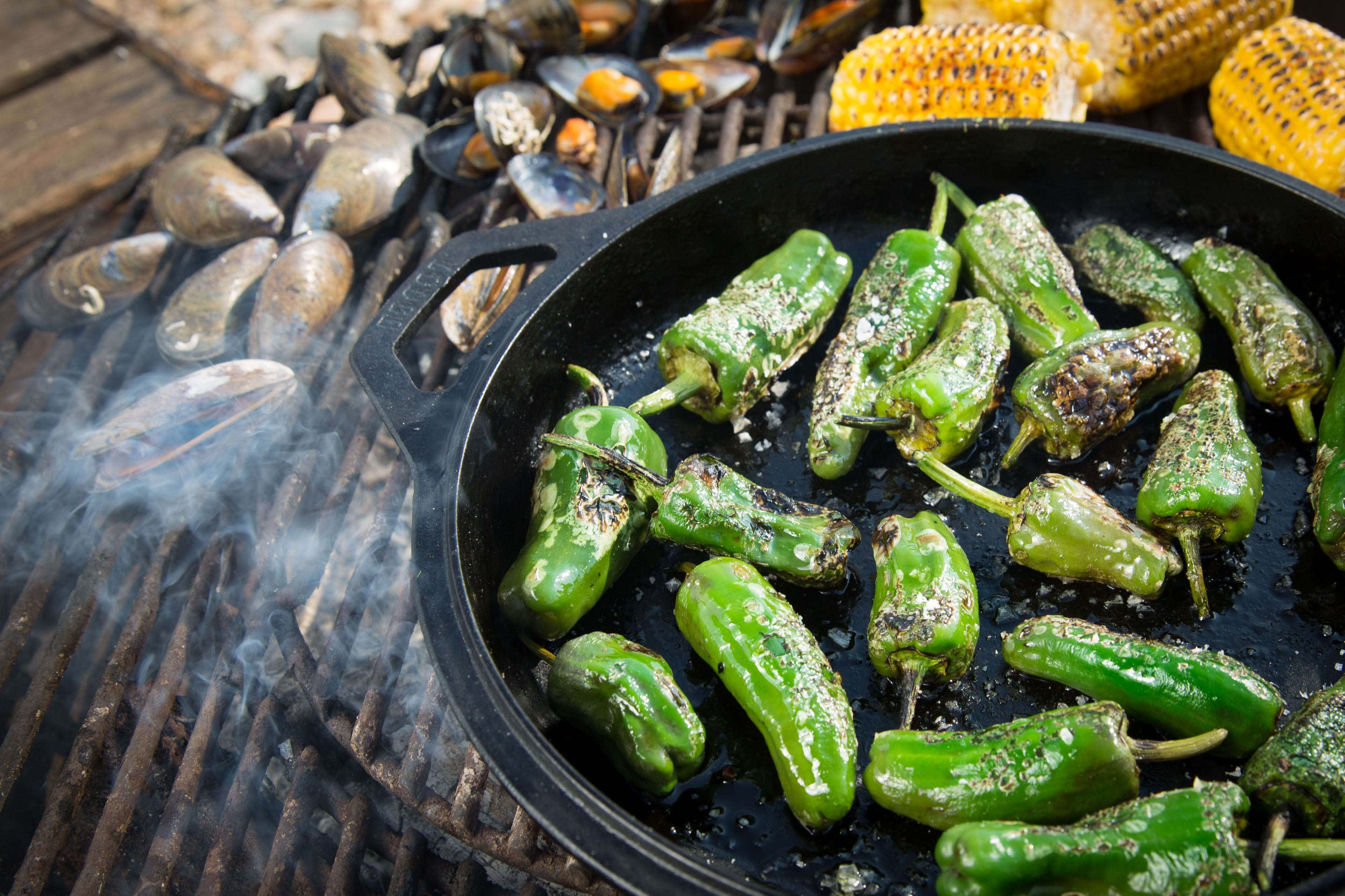 Mussels, corn and peppers cooking on the bbq.